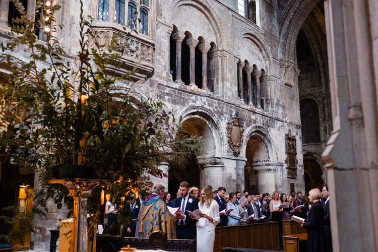 Wedding Ceremony | Bride in Pleats Please Issey Miyak Dress | Groom in Beggars Run Suit | Chic London Wedding at St Bartholomew the Great Church & St John Bar & Restaurant | Helen Abraham Photography