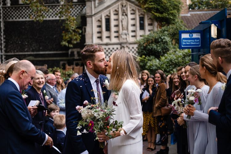 Confetti Exit | Bride in Pleats Please Issey Miyak Dress | Groom in Beggars Run Suit | Chic London Wedding at St Bartholomew the Great Church & St John Bar & Restaurant | Helen Abraham Photography