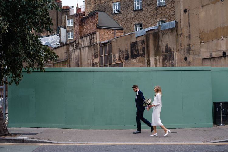 Bride in Pleats Please Issey Miyak Dress | Groom in Beggars Run Suit | Chic London Wedding at St Bartholomew the Great Church & St John Bar & Restaurant | Helen Abraham Photography