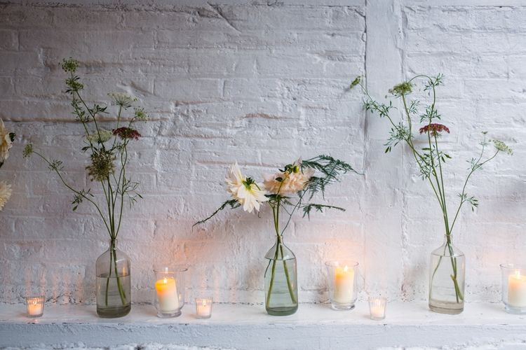 Flower Stems in Bottles Wedding Decor | Chic London Wedding at St Bartholomew the Great Church & St John Bar & Restaurant | Helen Abraham Photography