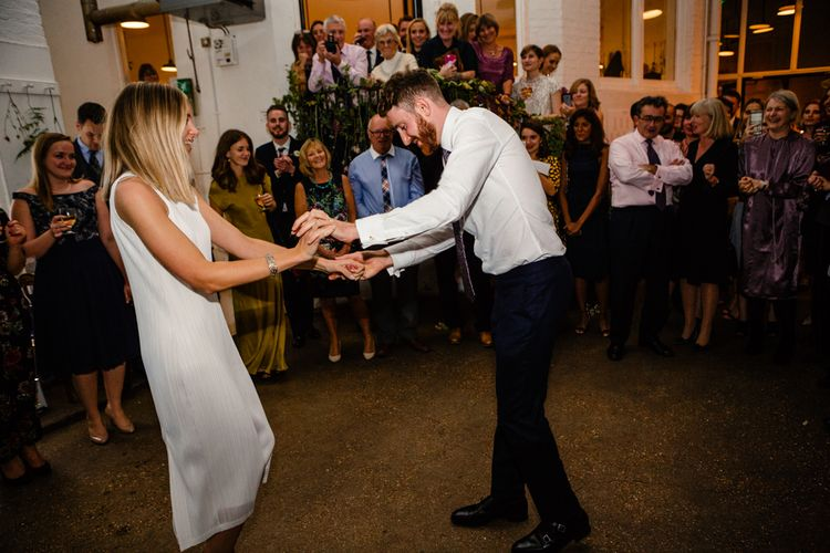 First Dance | Bride in Pleats Please Issey Miyak Dress | Groom in Beggars Run Suit | Chic London Wedding at St Bartholomew the Great Church & St John Bar & Restaurant | Helen Abraham Photography