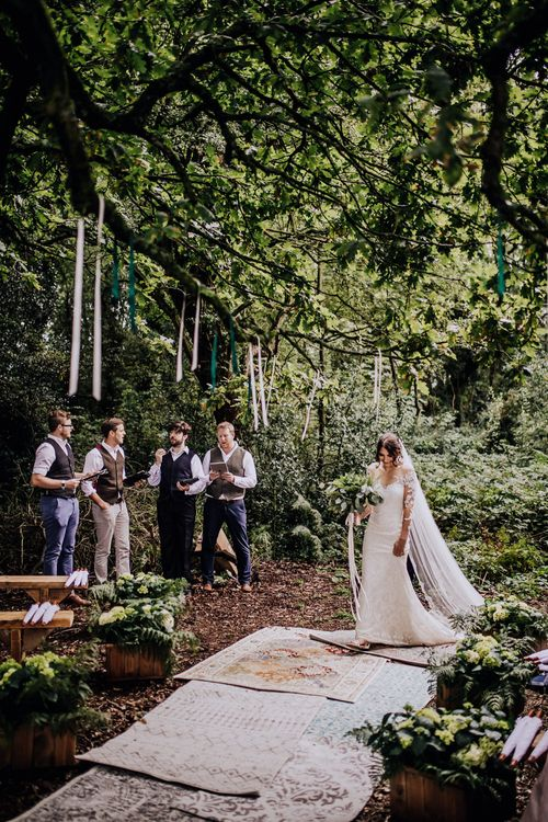Outdoor Wedding Ceremony | Bride in Rosa Clara Naim Bridal Gown | Persian Rug Aisle | Stylish Woodland Wedding in Cheshire | Clara Cooper Photography | Story Board Weddings Films