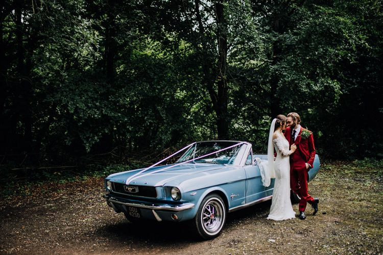 Mustang Wedding Car | Bride in Rosa Clara Naim Bridal Gown | Groom in Bespoke Burgundy Suit | Stylish Woodland Wedding in Cheshire | Clara Cooper Photography | Story Board Weddings Films