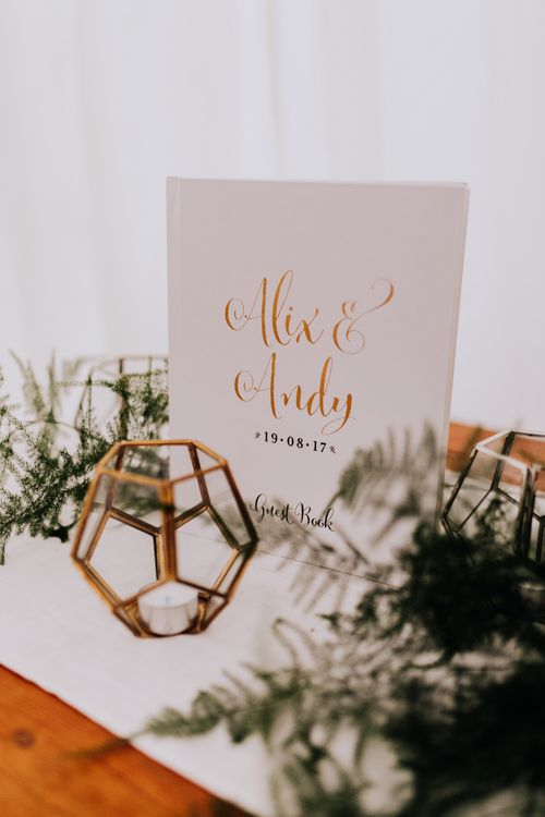 Guest Book | Greenery & Copper Wedding Decor | Stylish Woodland Wedding in Cheshire | Clara Cooper Photography | Story Board Weddings Films