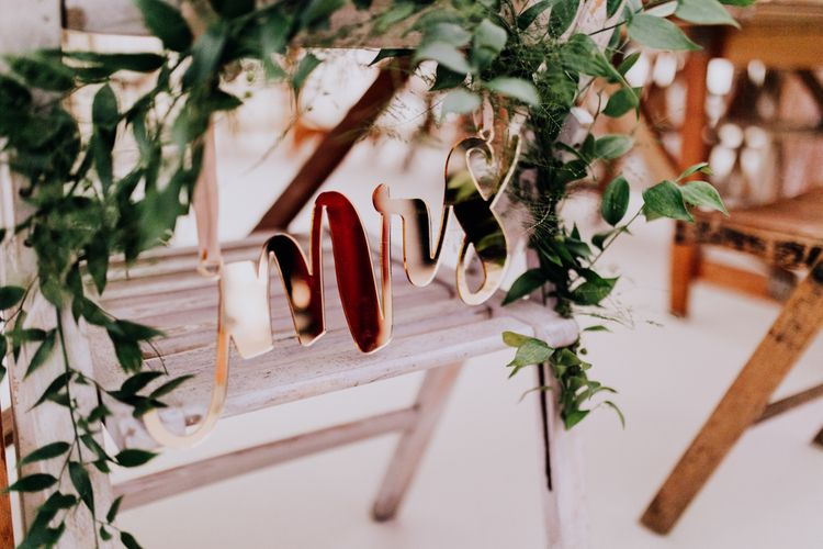 Copper Mrs Chair Back Decor | Stylish Woodland Wedding in Cheshire | Clara Cooper Photography | Story Board Weddings Films