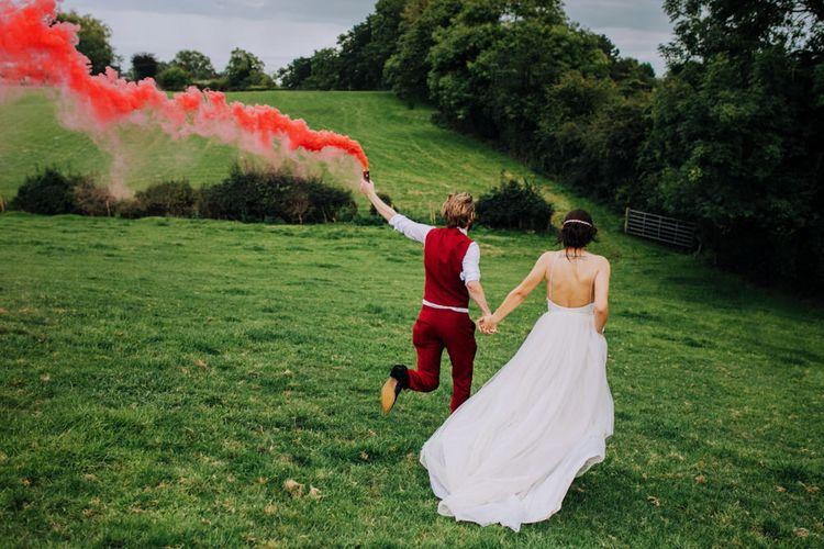 Smoke Bomb | Bride in Bo & Luca Bridal Gown | Groom in Bespoke Burgundy Suit | Stylish Woodland Wedding in Cheshire | Clara Cooper Photography | Story Board Weddings Films