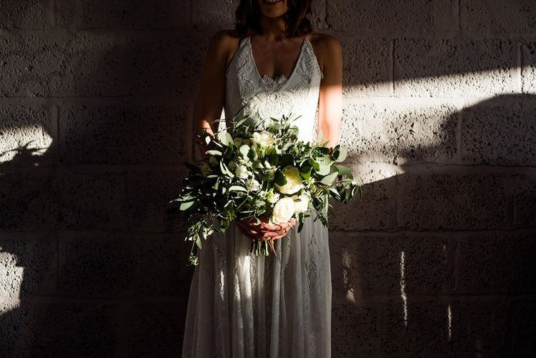 Oversized Wedding Bouquet With Greenery and White Flowers