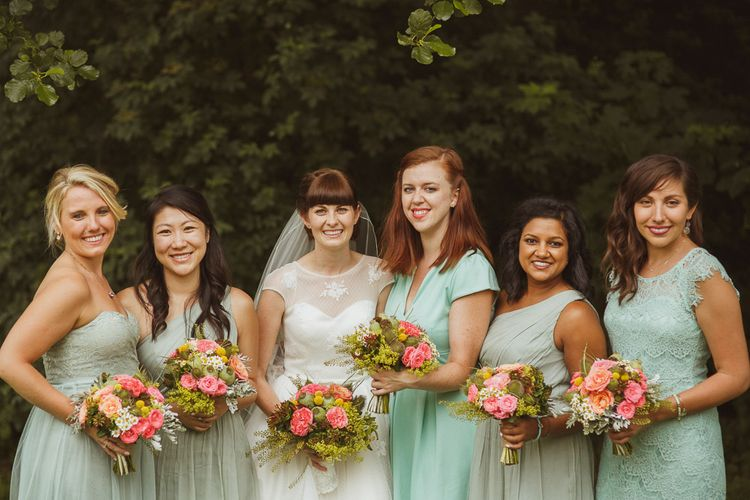 Wedding Party In Green With Brightly Coloured Bouquets