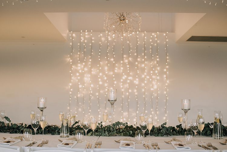 Fairy Light Curtain Top Table Backdrop | Sophisticated White & Green Colour Scheme for an Outdoor Australian Wedding at Summer Grove | Photography & Film by Mad Rose Films