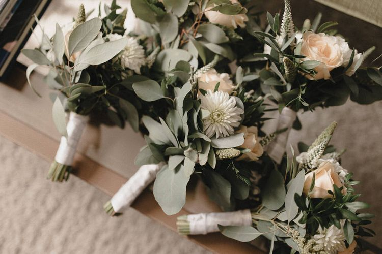 White & Sage Green Floral Buttonholes