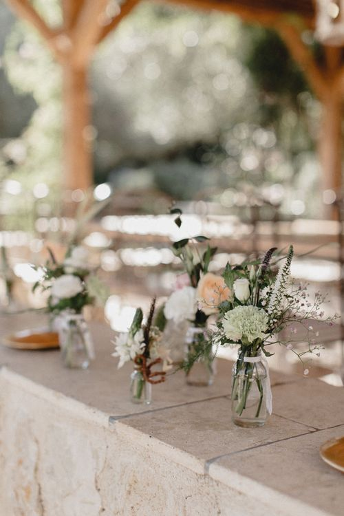 Wedding Table Scape With Cream Linen And Pink Jam Jar Flowers