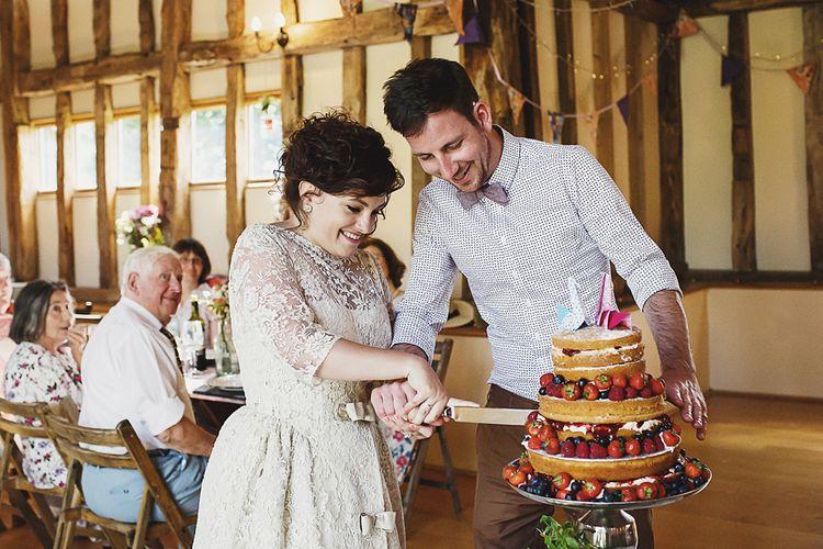 Bride & Groom Cutting The Naked Wedding Cake