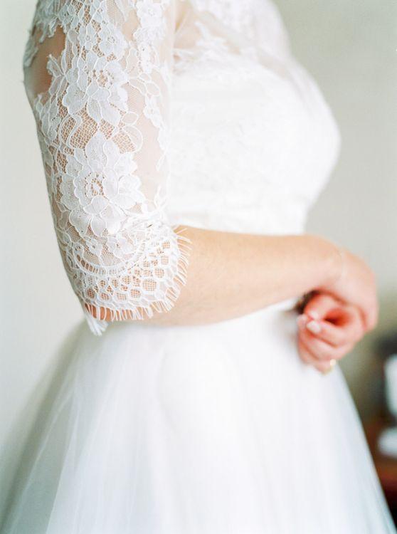 Lace three quarter sleeved wedding dress