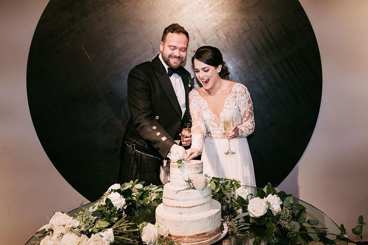Bride & Groom Cutting the Cake | Semi Naked Wedding Cake | Stylish Wedding at the M Building in the Miami Art District | Sara Lobla Photography