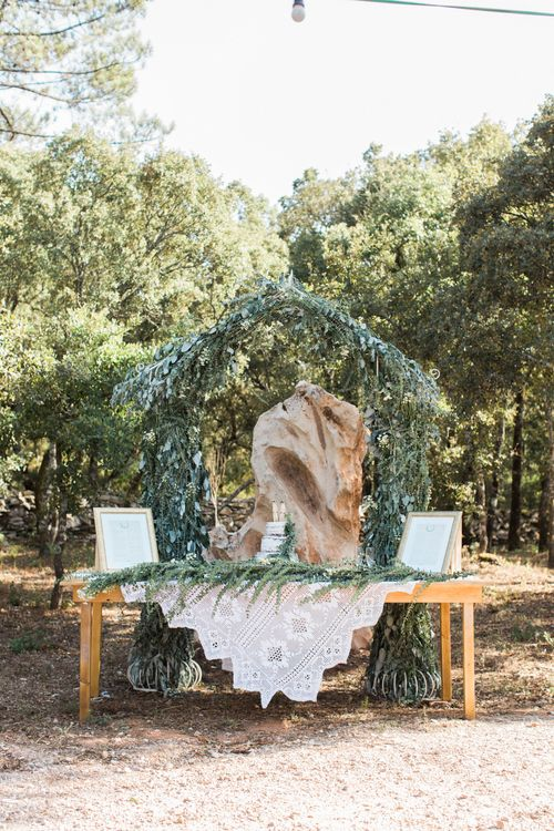Outdoor Wedding Cake Table with Greenery Arch