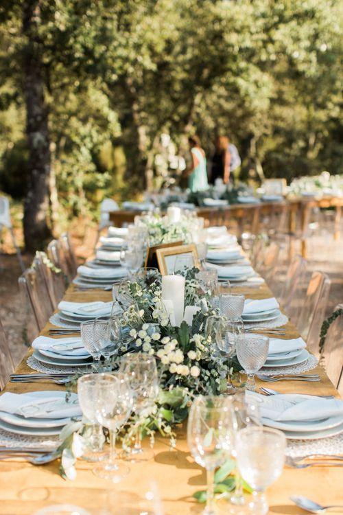 Elegant Trestle Table with Green Crockery