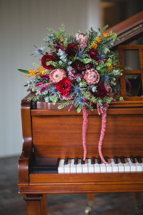 Deep Red, Pink & Greenery Protea Bouquet | Industrial Wedding at The West Mill Venue | Sarah Gray Photography