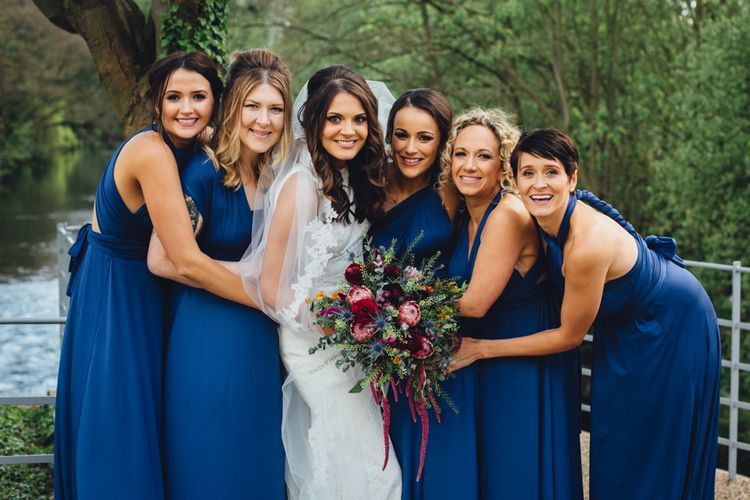 Bridesmaids in Midnight Blue Multiway Dresses | Industrial Wedding at The West Mill Venue | Sarah Gray Photography