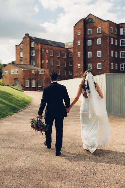 Bride in Pronovias Ornani Bridal Gown & Veil | Groom in Charles Tyrwitt Midnight Blue Tuxedo | Industrial Wedding at The West Mill Venue | Sarah Gray Photography