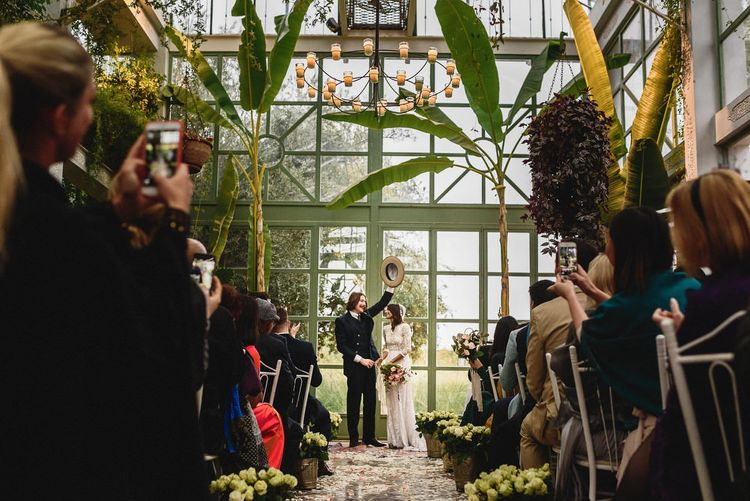 Glasshouse Wedding Ceremony | Bride in Bespoke Hermione de Paula Bridal Gown | Groom in Thomas Farthing | Stylish Destination Wedding in Marrakesh | Andy Gaines Photography
