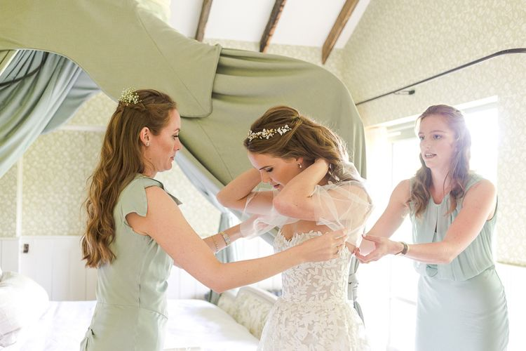 Bridal Preparations | Bride in Mira Zwillinger Bridal Gown | Pale Green Ghost Bridesmaid Dresses | Rustic Soho Farmhouse Ceremony with PapaKata Sperry Tent Greenery filled Reception | Marianne Taylor Photography | Will Warr Films