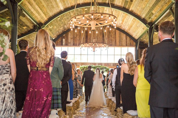 Bride in Mira Zwillinger Bridal Gown | Rustic Soho Farmhouse Ceremony with PapaKata Sperry Tent Greenery filled Reception | Marianne Taylor Photography | Will Warr Films