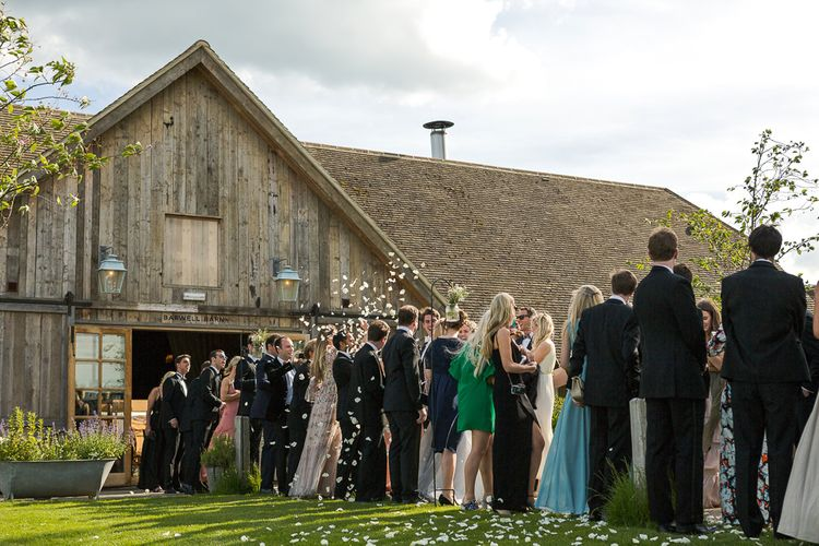 Confetti Moment | Bride in Mira Zwillinger Bridal Gown | Rustic Soho Farmhouse Ceremony with PapaKata Sperry Tent Greenery filled Reception | Marianne Taylor Photography | Will Warr Films