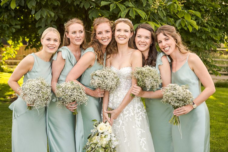 Bride in Mira Zwillinger Bridal Gown | Pale Green Ghost Bridesmaid Dresses | Rustic Soho Farmhouse Ceremony with PapaKata Sperry Tent Greenery filled Reception | Marianne Taylor Photography | Will Warr Films