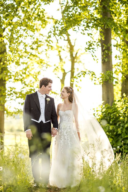 Bride in Mira Zwillinger Bridal Gown | Groom in Black Tie | Rustic Soho Farmhouse Ceremony with PapaKata Sperry Tent Greenery filled Reception | Marianne Taylor Photography | Will Warr Films
