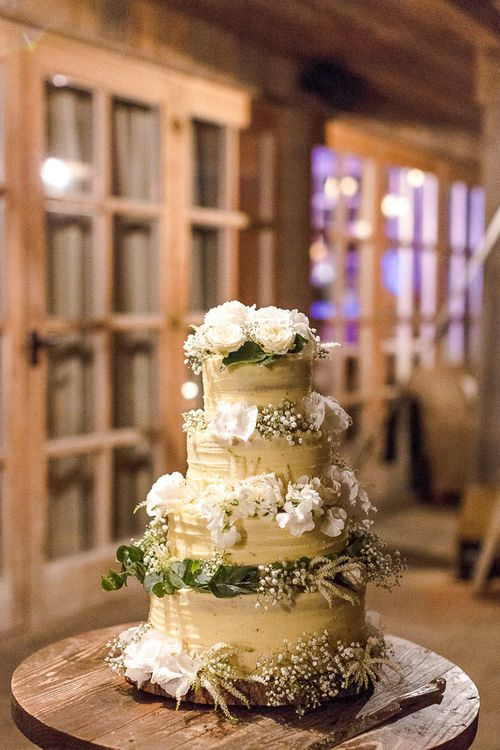 Buttercream Icing Wedding Cake | Rustic Soho Farmhouse Ceremony with PapaKata Sperry Tent Greenery filled Reception | Marianne Taylor Photography | Will Warr Films