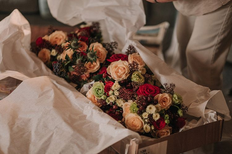 Red & Orange Bouquets | DIY Lord of the Rings Themed Wedding at Monks Barn in Maidenhead | Jason Mark Harris Photography | Cinematic Films By J