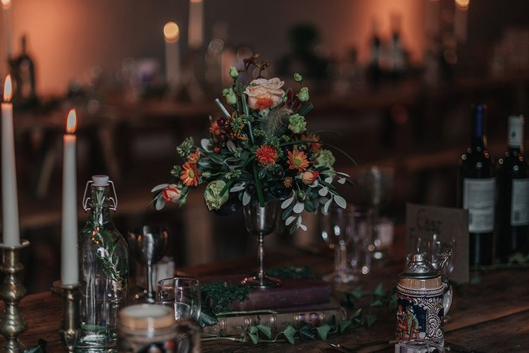 Flower Stems in Goblets on Vintage Book Stack | DIY Lord of the Rings Themed Wedding at Monks Barn in Maidenhead | Jason Mark Harris Photography | Cinematic Films By J