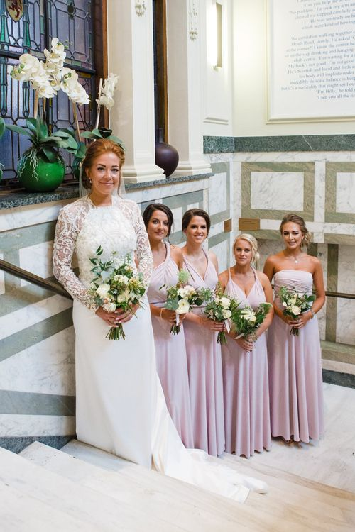 Bride in Bespoke Emma Beaumont Bridal Gown | Bridesmaids in Coast Pink Multiway Dresses | Greenery, White & Gold Stylish Wedding at The Town Hall Hotel in London | Lucy Davenport Photography