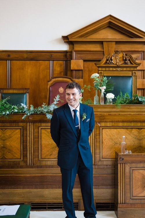 Groom in Navy Suit | Greenery, White & Gold Stylish Wedding at The Town Hall Hotel in London | Lucy Davenport Photography