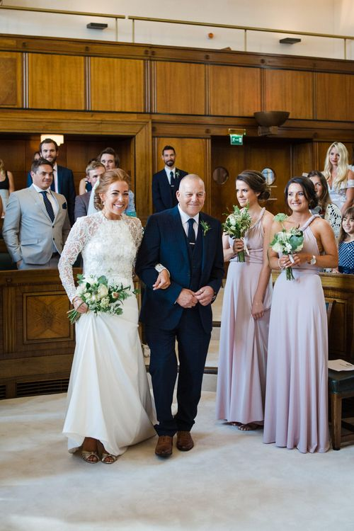 Wedding Ceremony | Bridal Entrance in Bespoke Emma Beaumont Gown | Greenery, White & Gold Stylish Wedding at The Town Hall Hotel in London | Lucy Davenport Photography