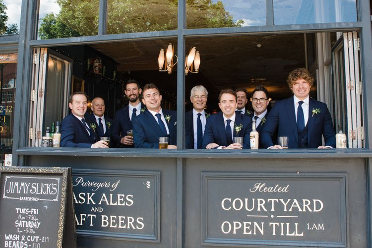 Groomsmen in Navy Suits | Greenery, White & Gold Stylish Wedding at The Town Hall Hotel in London | Lucy Davenport Photography