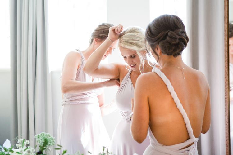 Bridesmaids in Pink Coast Multiway Dresses | Greenery, White & Gold Stylish Wedding at The Town Hall Hotel in London | Lucy Davenport Photography