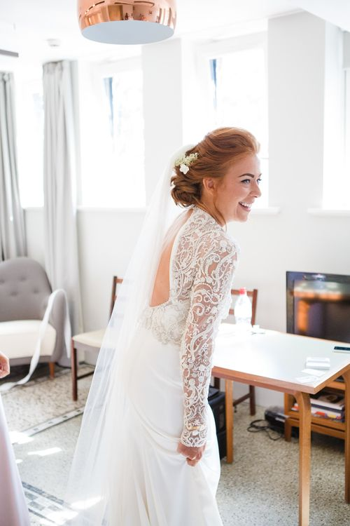 Bride in Bespoke Emma Beaumont Bridal Gown | Greenery, White & Gold Stylish Wedding at The Town Hall Hotel in London | Lucy Davenport Photography