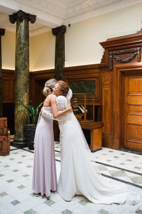 Bride in Bespoke Emma Beaumont Bridal Gown | Bridesmaid in Coast Multiway Dress | Greenery, White & Gold Stylish Wedding at The Town Hall Hotel in London | Lucy Davenport Photography