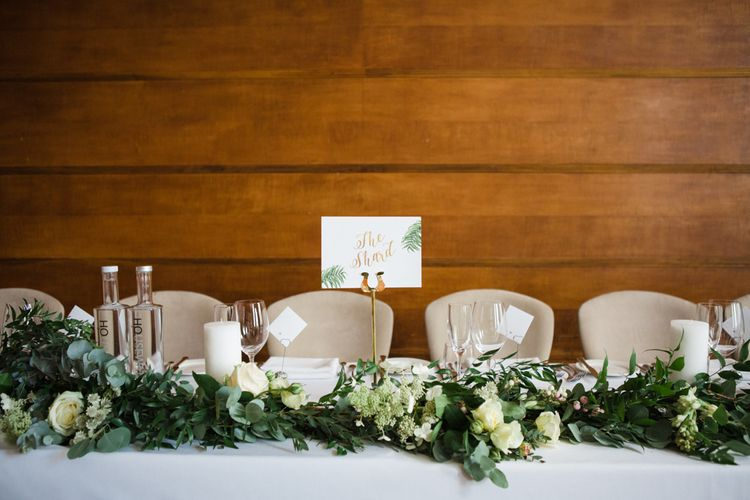 Greenery & White Flower Top Table Garland | Greenery, White & Gold Stylish Wedding at The Town Hall Hotel in London | Lucy Davenport Photography