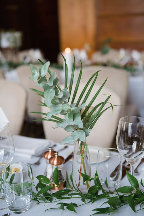 Foliage Stems in Bottles | Greenery, White & Gold Stylish Wedding at The Town Hall Hotel in London | Lucy Davenport Photography
