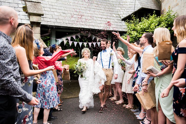 Confetti Moment | Bride in Lace Wedding Dress | Groom in Shorts, Braces & Bow Tie | Coastal Wedding at Driftwood Spas St Agnes, Cornwall | Jessica Grace Photography