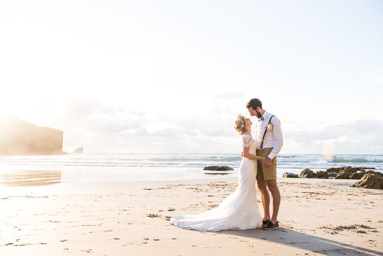 Beach Portrait | Bride in Lace Wedding Dress | Groom in Shorts, Braces & Bow Tie | Coastal Wedding at Driftwood Spas St Agnes, Cornwall | Jessica Grace Photography