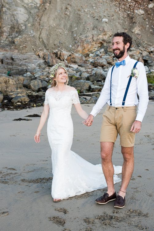 Beach | Bride in Lace Wedding Dress | Groom in Shorts, Braces & Bow Tie | Coastal Wedding at Driftwood Spas St Agnes, Cornwall | Jessica Grace Photography