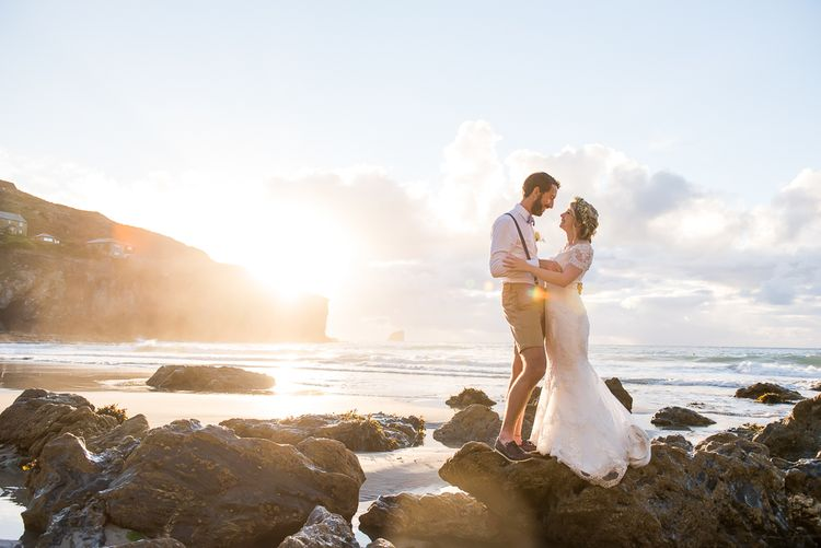 Golden Hour | Bride in Lace Wedding Dress | Groom in Shorts, Braces & Bow Tie | Coastal Wedding at Driftwood Spas St Agnes, Cornwall | Jessica Grace Photography