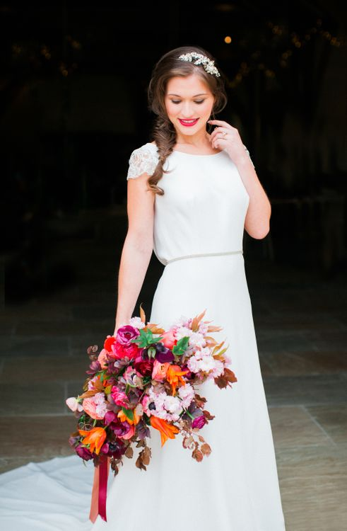Brightly Coloured Bridal Bouquet And Jesus Peiro Gown For An Elegant Barn Wedding