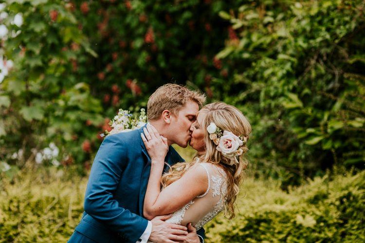 Bride in Lace Lillian West Wedding Dress | Groom in T.M Lewin Navy Suit | Benjamin Stuart Photography