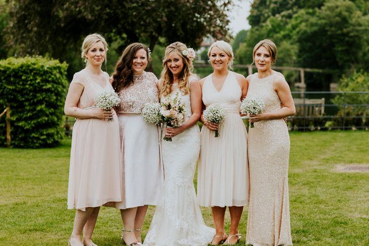 Bridesmaids in Highstreet Nude Dresses | Bride in Lace Lillian West Bridal Gown | Benjamin Stuart Photography