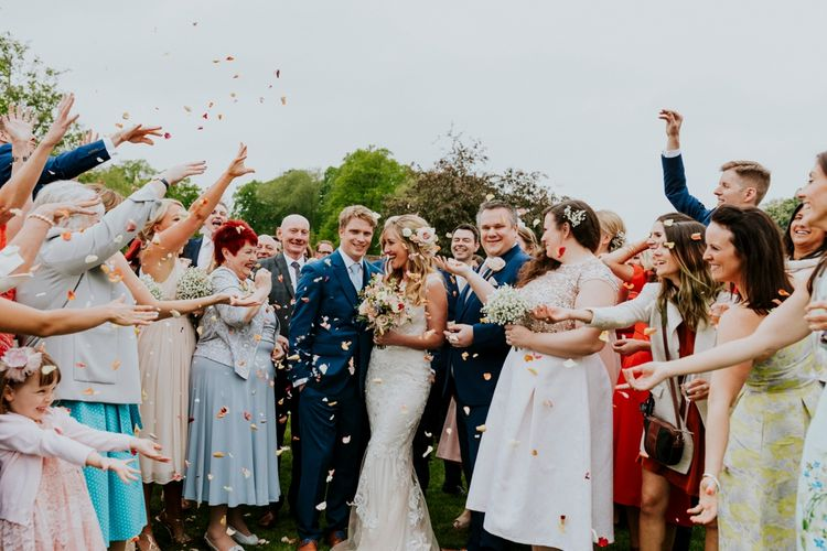 Confetti Moment | Bride in Lace Lillian West Wedding Dress | Groom in T.M Lewin Navy Suit | Benjamin Stuart Photography