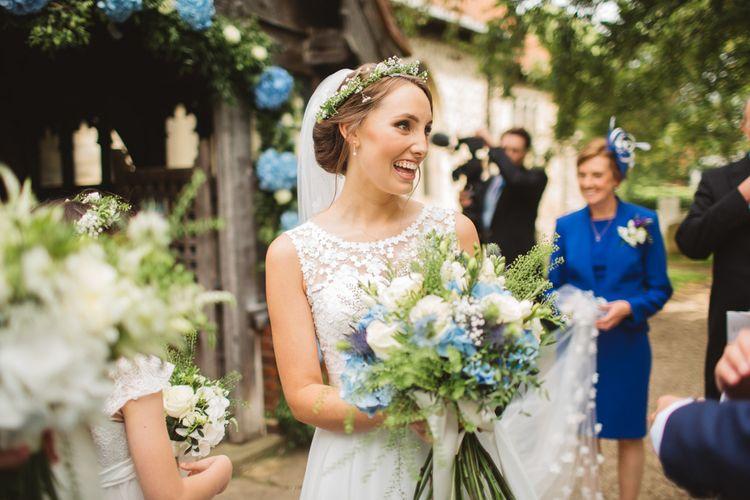 Bride in Lace Bodice & Ingrida Bridal Wedding Dress with Blue & White Hydrangea & Stock Bouquet